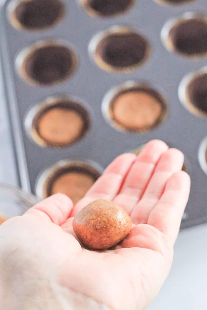 Rolling almond butter balls