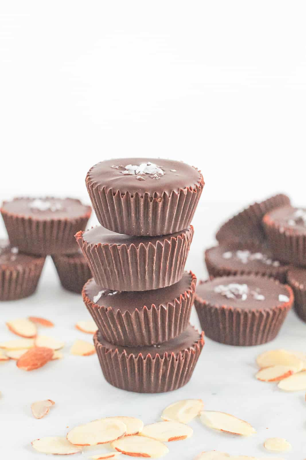 Homemade Dark Chocolate Almond Butter Cups stalked four high.