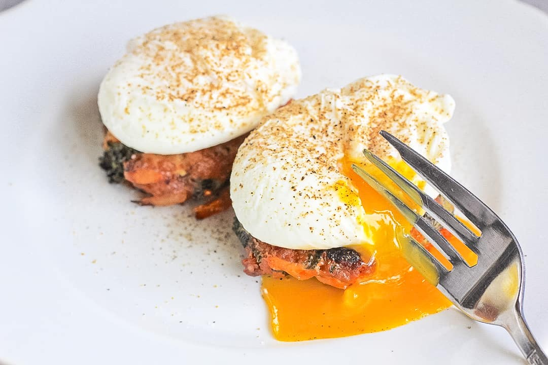 Poached eggs on chorizo veggie breakfast sausage patties.