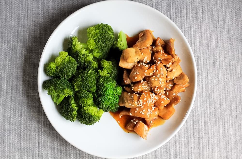 Healthy Orange Chicken with steamed broccoli.