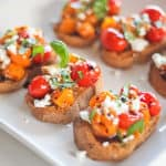 Cherry tomato crostini with goat cheese, basil and balsamic glaze.