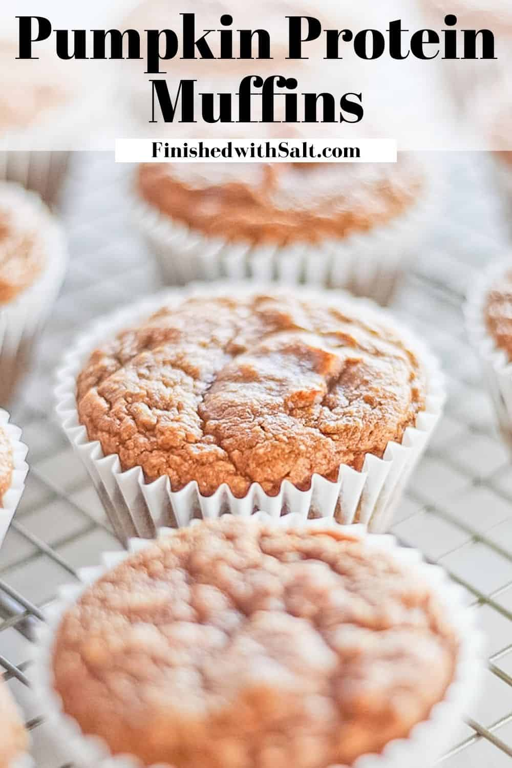 Muffins cooling on a metal rack with recipe title.