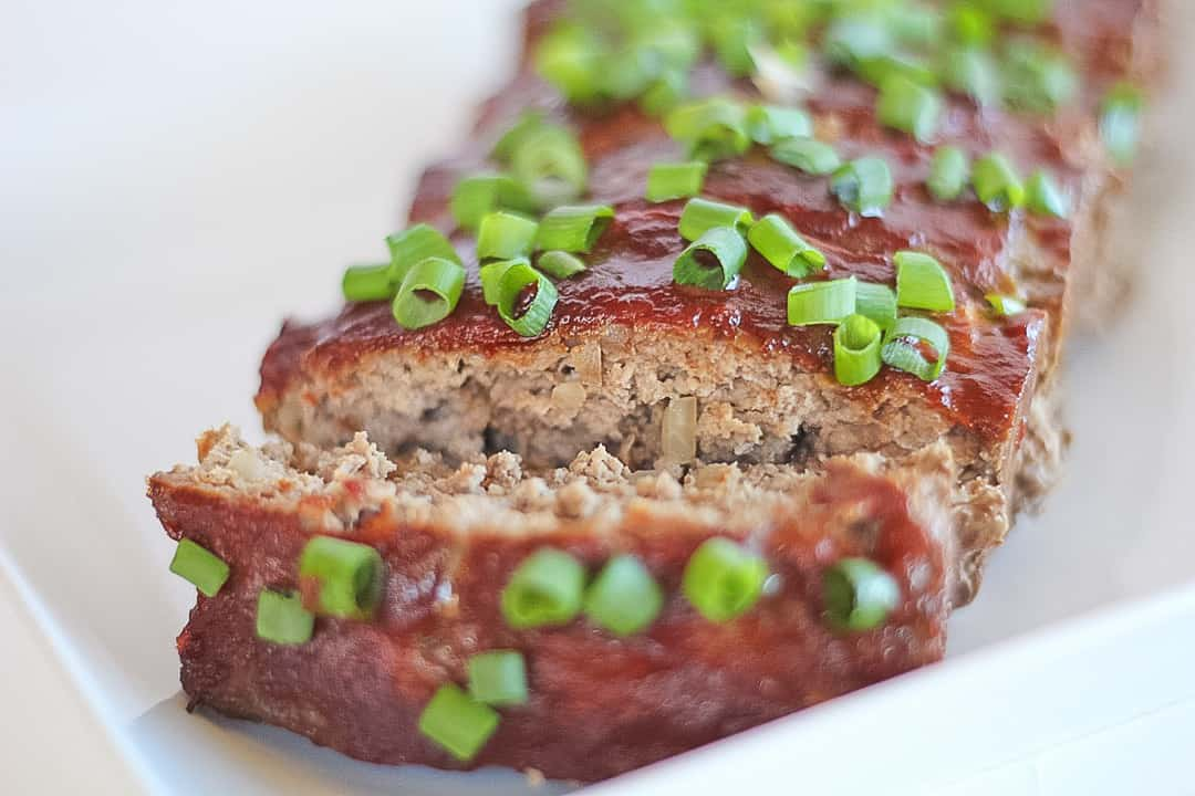 Paleo Meatloaf with an asian glaze and green onions on top.
