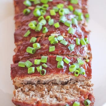 Whole30 Meatloaf with an asian glaze and green onions on top.