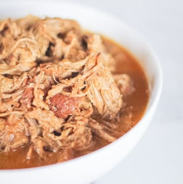 White bowl full of paleo and whole30 apple cider pulled pork.