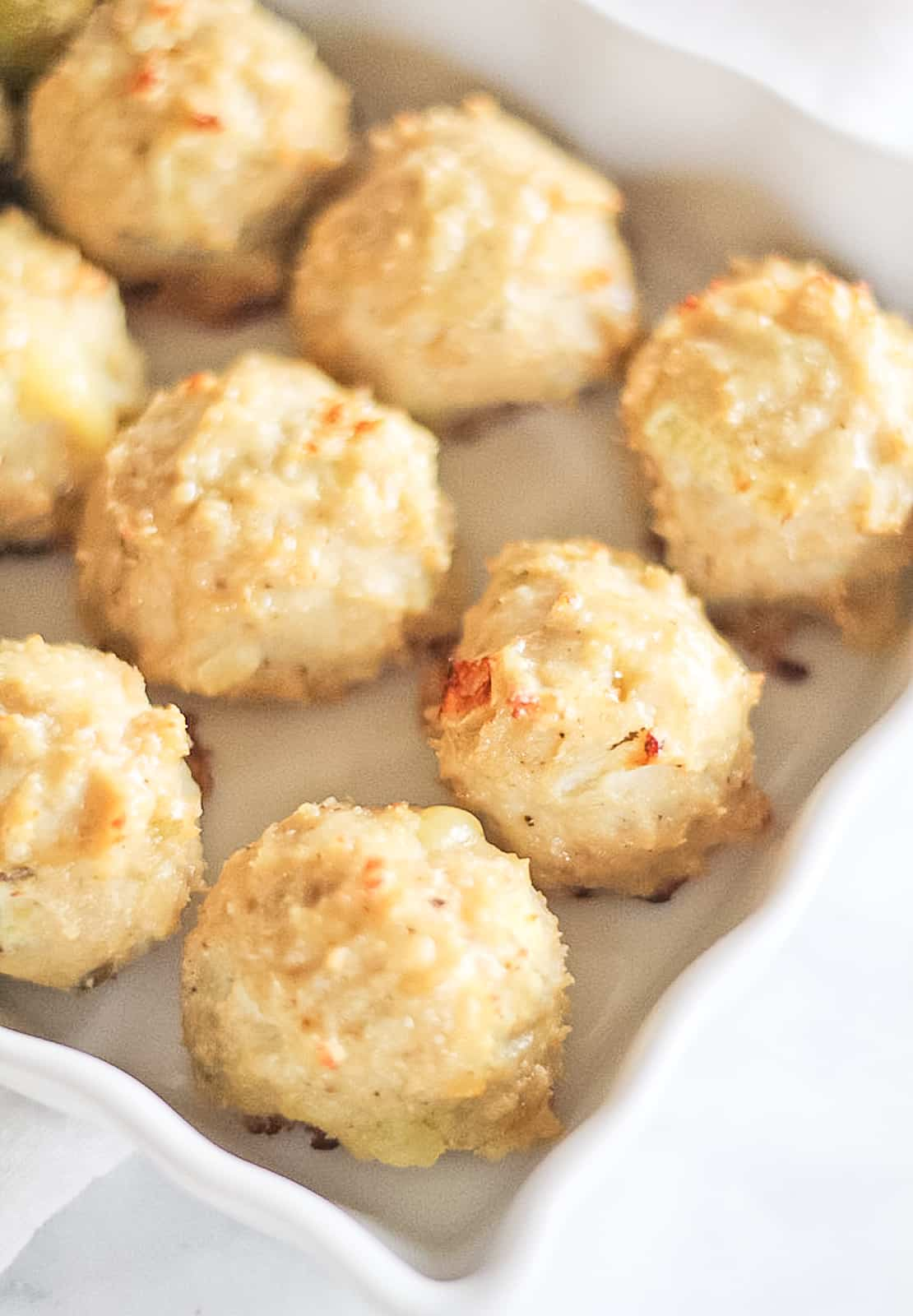 White platter of Healthy Chicken Meatballs with apple and cheddar.