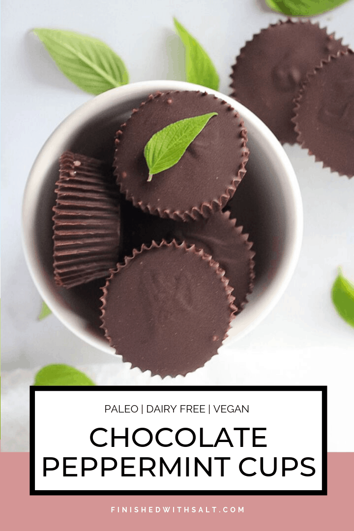 Chocolate Peppermint Cups in a white bowl with mint leaves on top.