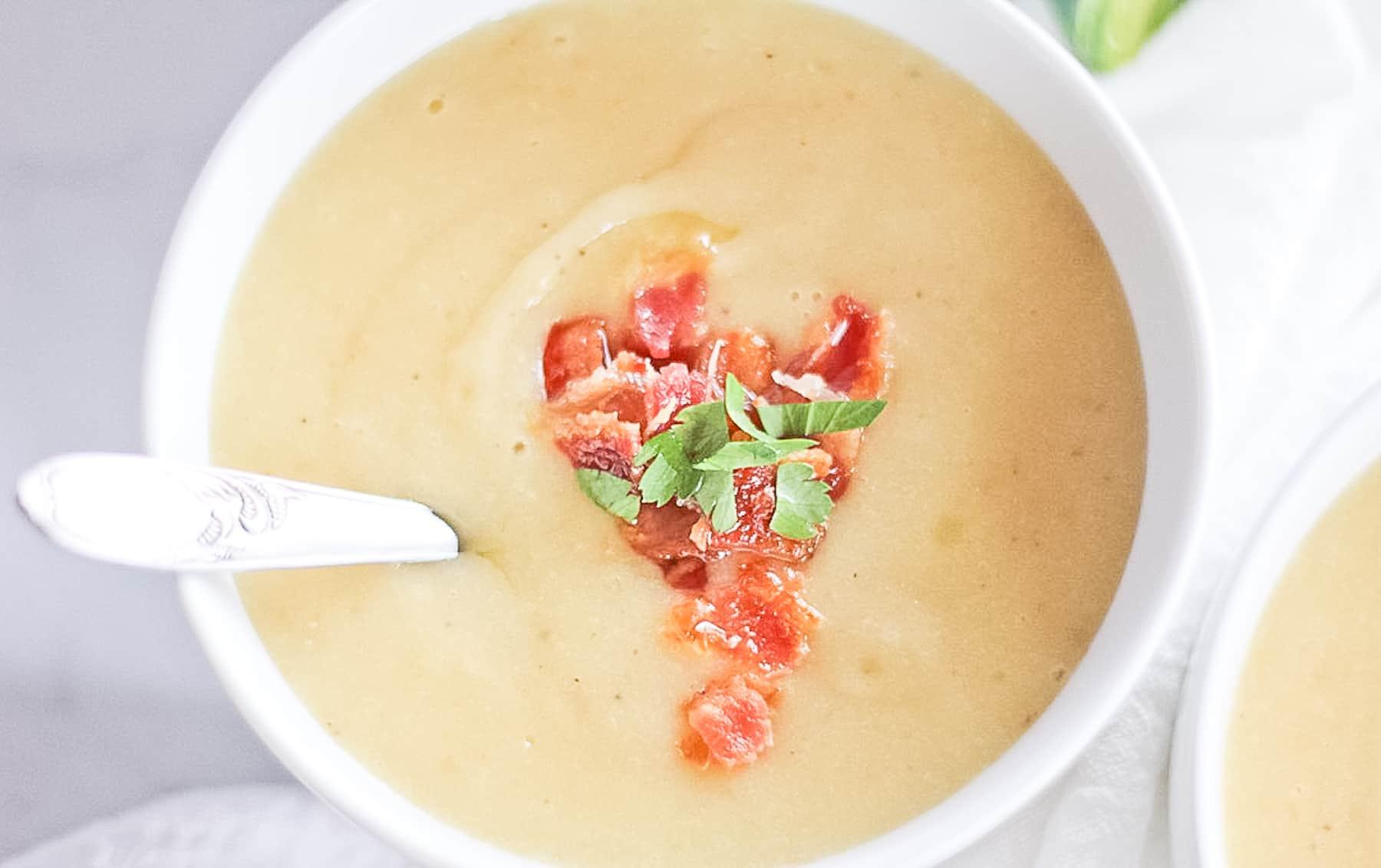 A close up of potato soup with bacon.