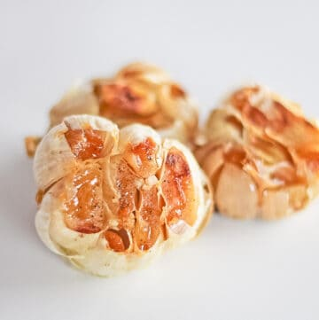 Three heads of roasted garlic for how to roast garlic recipe.