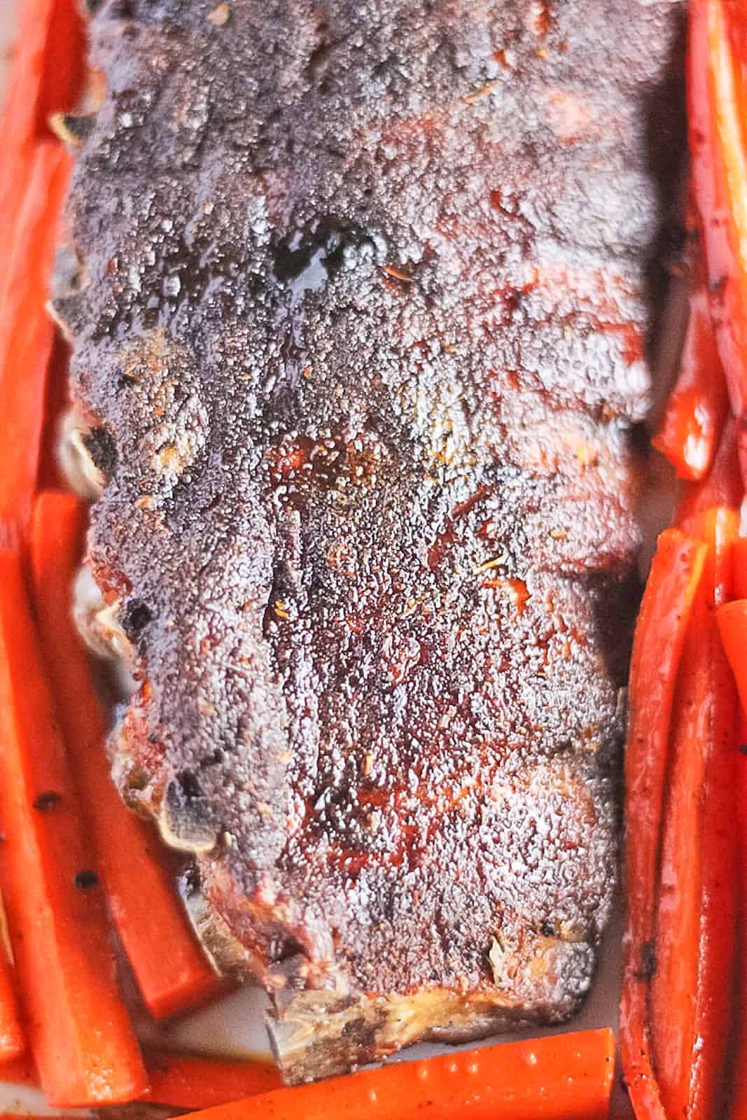 Close up of a dry rubbed rack of ribs.