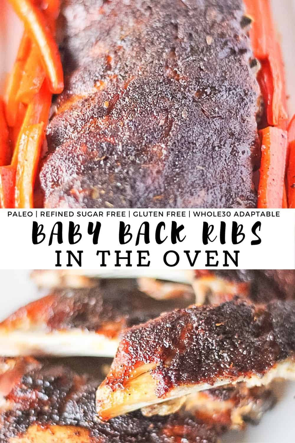 Rack of ribs on a sheet pan surrounded by carrots.