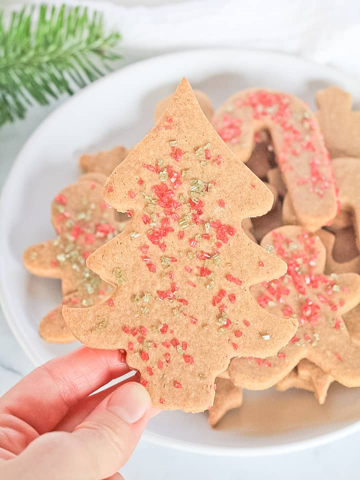 Cassava flour Christmas sugar cookies decorated with sprinkles.
