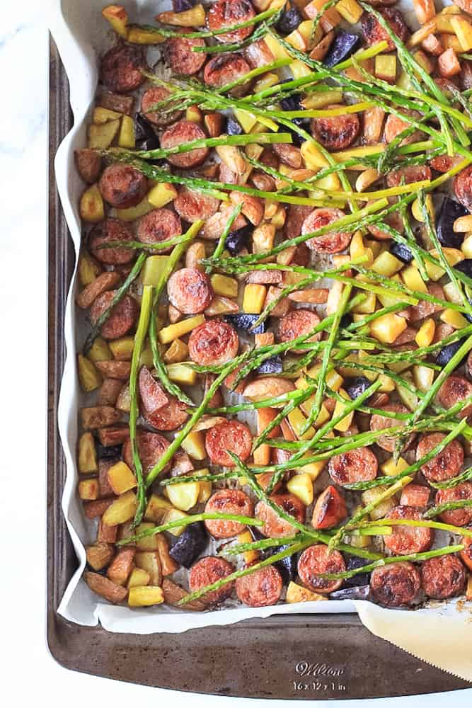 Sheet Pan dinner full of sausage, asparagus and crispy potatoes.