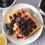 Easy overnight gluten free waffle recipe with blackberry syrup.
