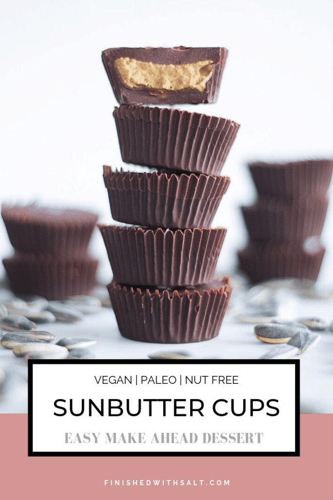 Stacks of sunbutter cups with a bite taken from one dessert cup.
