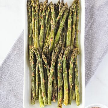 Whole30 Asparagus on a white platter.