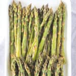 Keto Asparagus on a white serving plate.