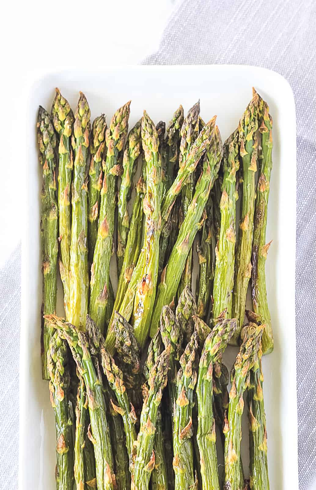 Roasted Asparagus on a white serving plate.