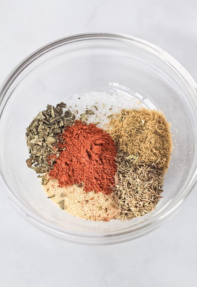 Spice blend for the pork, garlic powder, cumin, salt, dried basil, dried oregano, dried rosemary, dried thyme, smoked paprika and black pepper.
