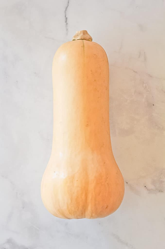 Whole Butternut Squash laying on a table.
