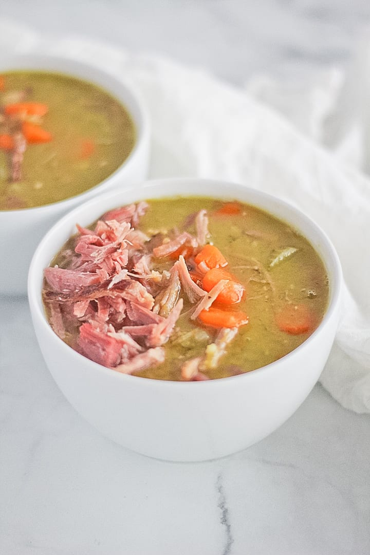 White bowl full of Instant Pot Split Pea and Ham Soup