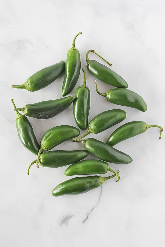 Pile of whole jalapeno peppers.