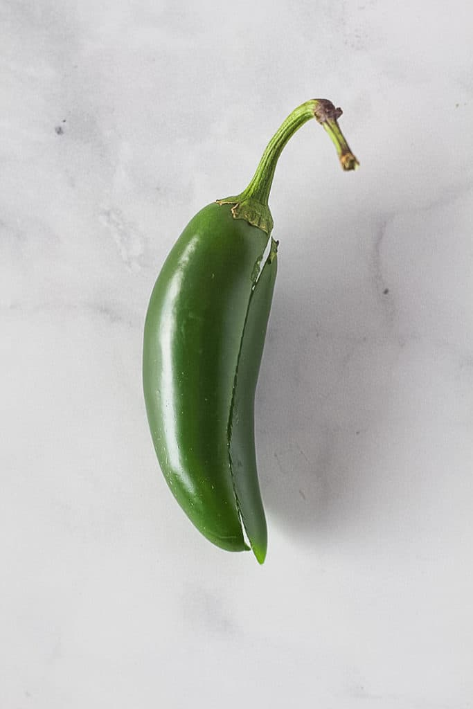 One jalapeno with a cut down the side.