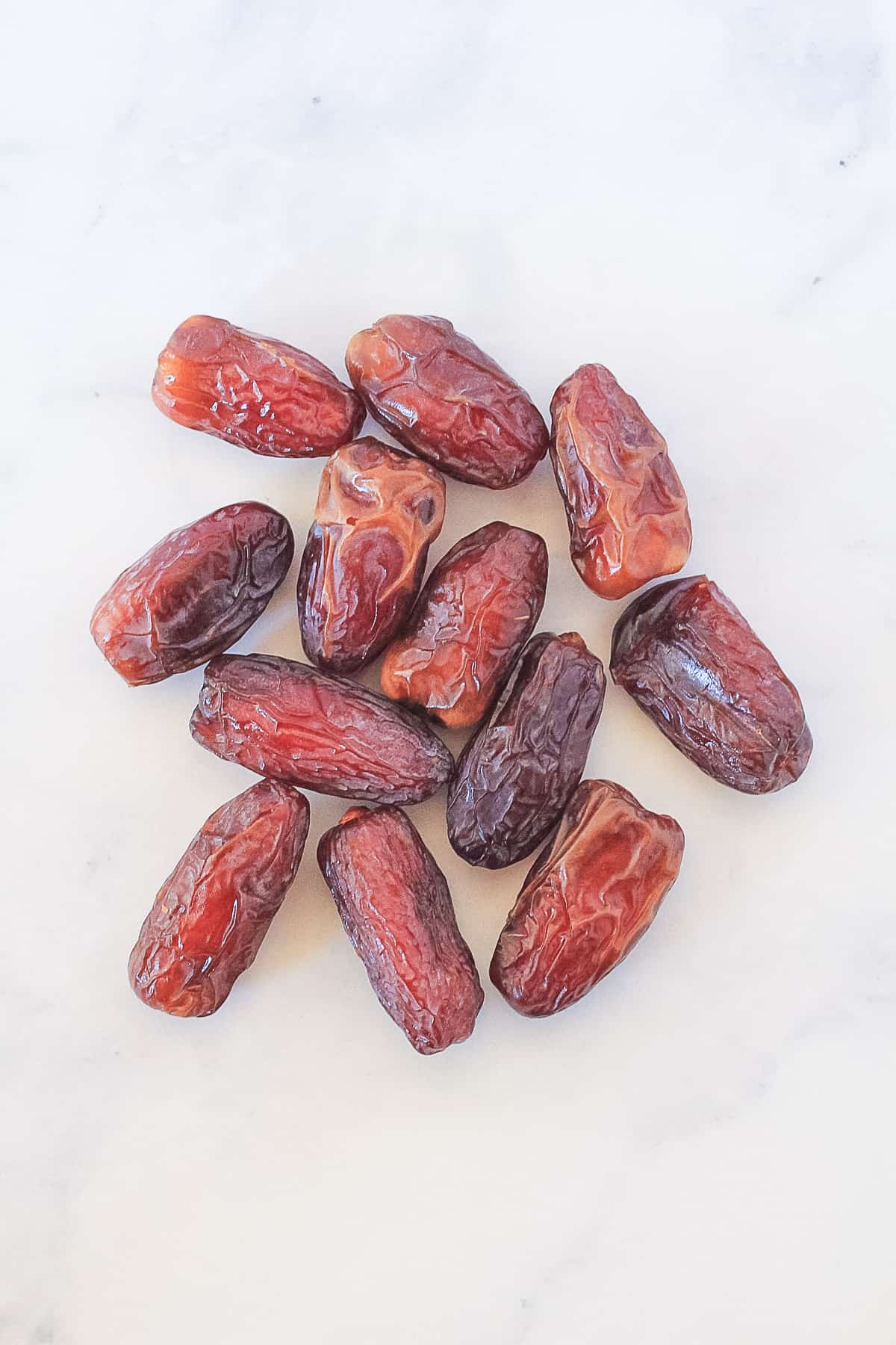 Pile of medjool dates on a marble background.
