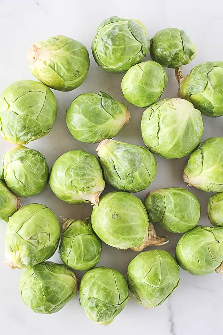 Raw whole brussels sprouts.