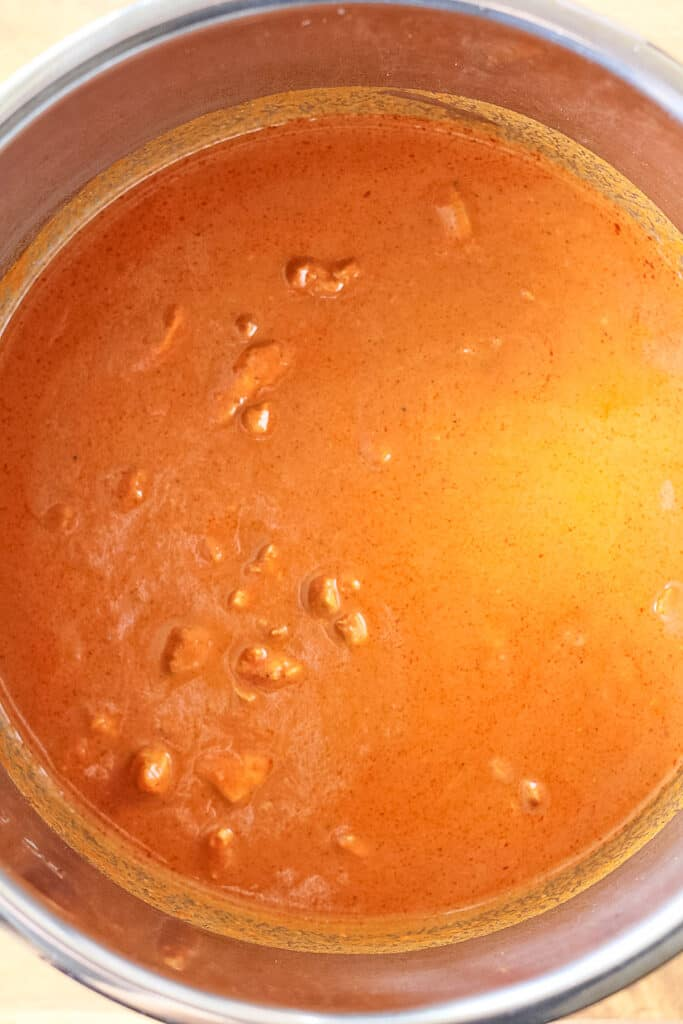 Inside the Instant Pot with Butter Chicken Curry ready to eat.