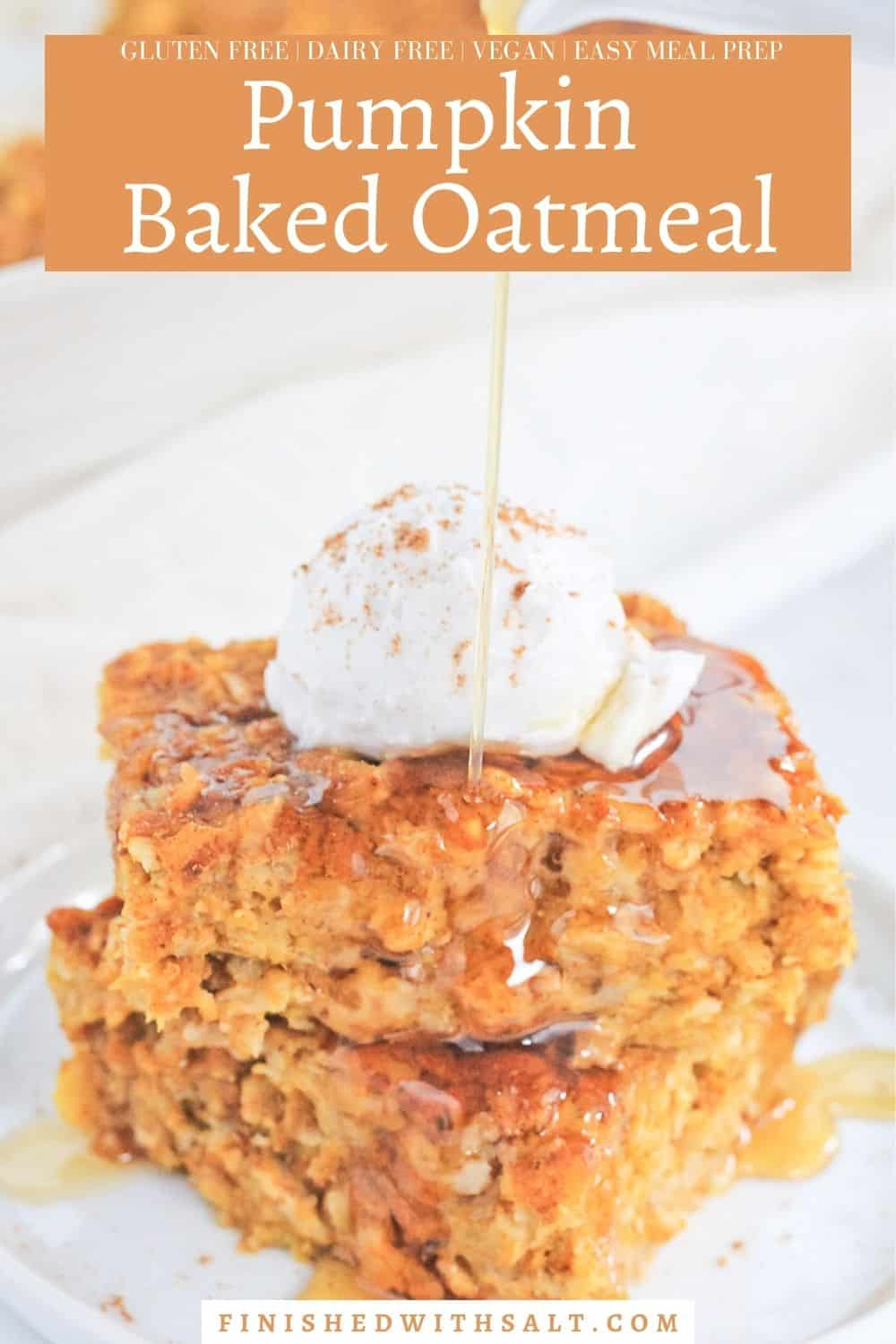 Two square of pumpkin baked oatmeal stacked on a white plate topped with a dollop of coconut cream, sprinkle of pumpkin pie spice and drizzle of maple syrup and the recipe title.