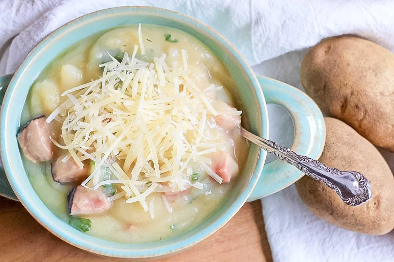 Bowl of Instant Pot Creamy Potato Ham & Kale Soup