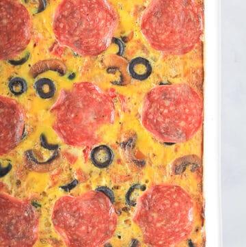 White 9x13 baking dish of Pizza Breakfast Casserole.