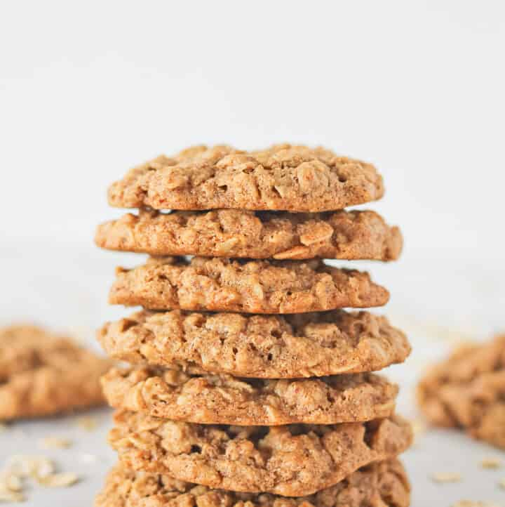 Vegan Almond Butter Cookies in a stack surrounded by oats.