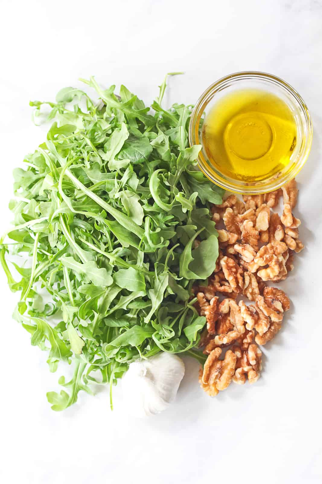 Arugula, walnuts, garlic and olive oil.