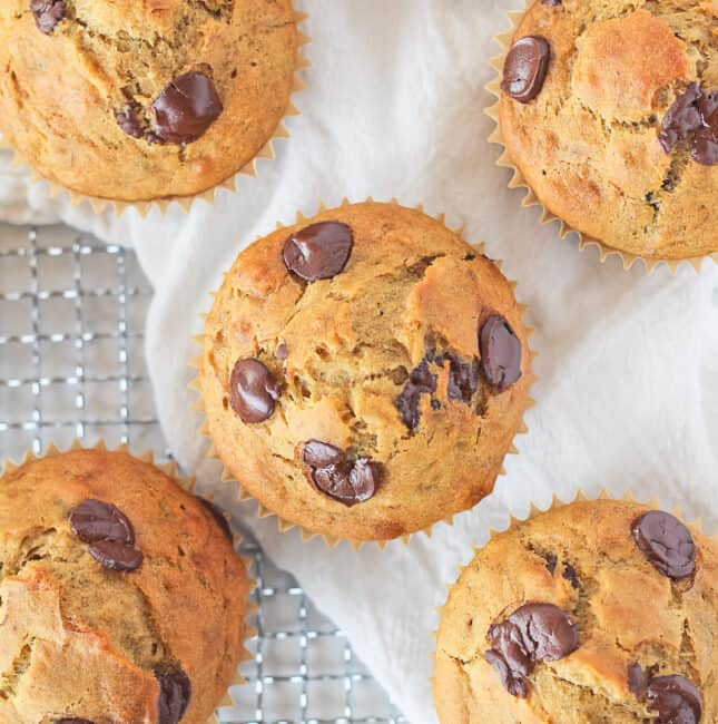 Top view of Banana Chocolate Chip Muffins on a white towel.