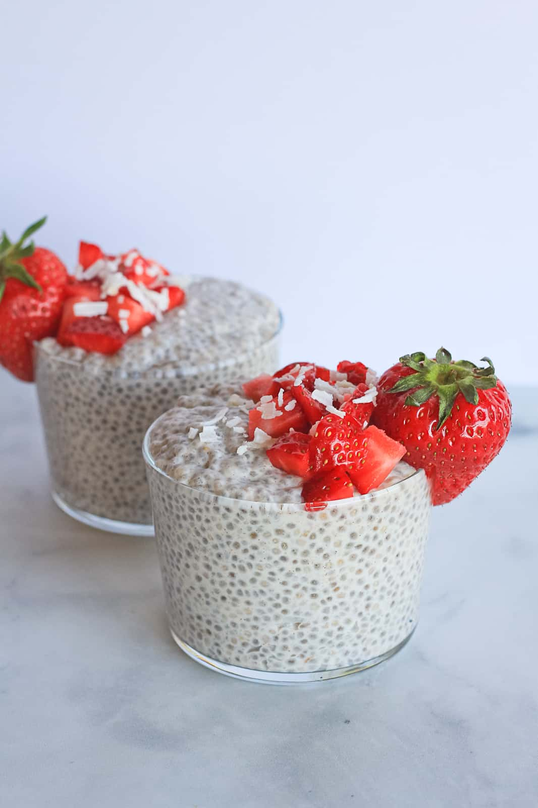 Two glass cups filled with chia seed pudding.