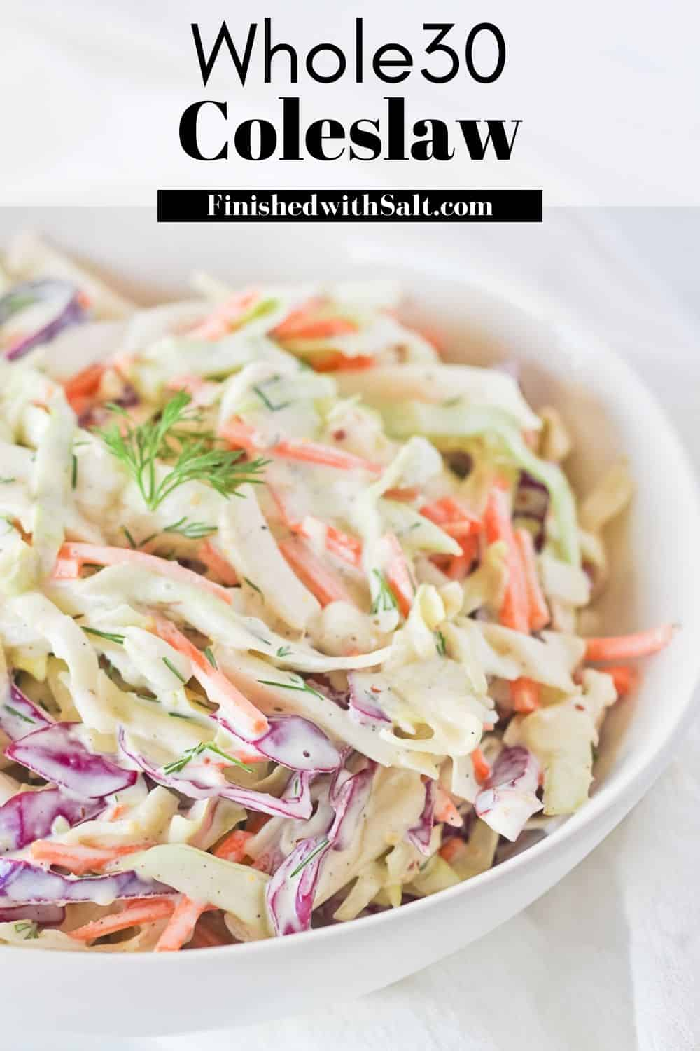 Whole30 Coleslaw with homemade dressing in a white bowl with recipe title.
