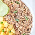 Slow cooker jerk chicken thighs with mango, jalapeno and lime.
