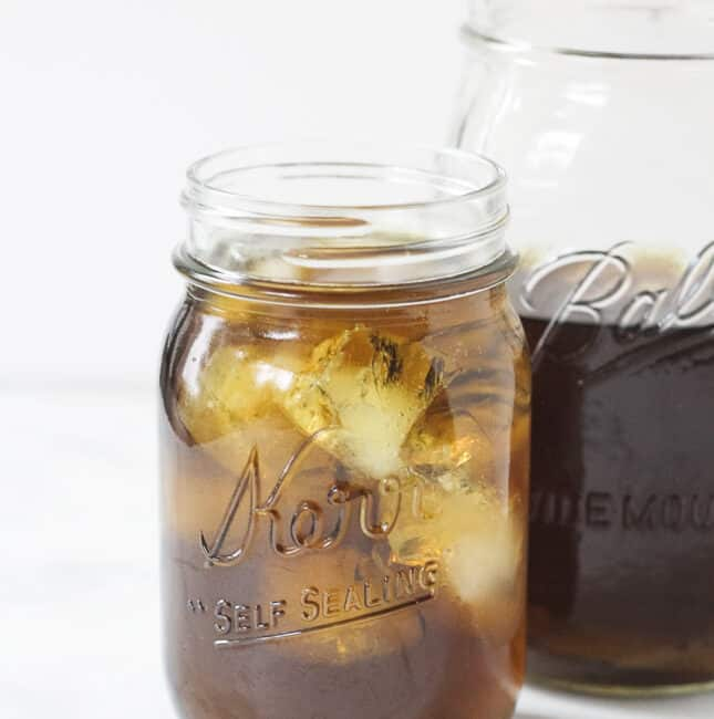 Iced nettle infusion in a mason jar.